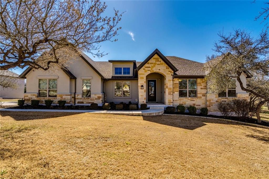 Stunning 2796 Sq Ft One Story On 1.39 Acres In The Highly Sought After Reagan's Overlook!! This Beautiful Home Features 4 Bedrooms, 2 1/2 Baths, 2 Living & 2 Dining. Wood & Tile Floors Throughout, No Carpet. Kitchen With Granite Countertops, Breakfast Bar, Stainless Appliances, Double Ovens, 5 Burner Gas Cooktop, Walk In Pantry & Bulter's Pantry With Wine Refrigerator. Family Room With A Beautiful Stone Fireplace & Wall Of Windows. Spacious Primary Bedroom Offers A Wonderful Large Bath With Walk In Shower, Garden Tub, Double Vanity With Granite Countertops & Walk In Closet. Back Patio With Stone Fireplace Overlooks A Wooded Acreage Homesite. Plenty Of Room For A Pool. Endless Possibilities. Easy Access To Schools & Shopping.