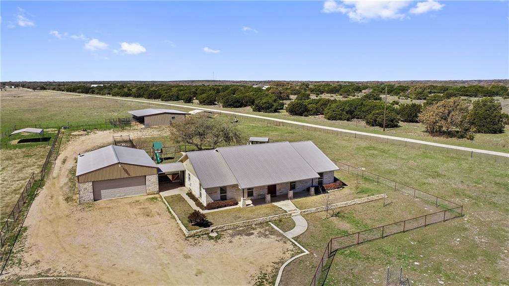 31+/- Acres with beautiful 3 bed 2 bath plus office (2216 sq ft) Home, oversized garage with workshop area, and horse/livestock barn.  Great access off of paved windmill rd and only about 5 minutes from downtown Burnet.  The house has an open floorplan with wood burning stove, granite counters, and beautiful stained concrete floors.  The oversized garage/workshop also has a bathroom inside.  The land is open with large scattered live oaks.  Great fences and cross fences.  There is a nice 3-sided barn with stalls that would be great for horses or livestock projects.  Water is supplied by a 15 gallon per minute water well on-site.