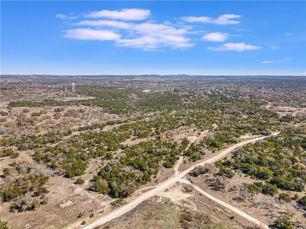 Beautiful 10 acre tract with almost 180 degree mile long views looking to the North overlooking a large ranch. This property has several great building locations and each one of them has views. The property has three terraces so you could build multiple homes and still not obstruct any views. This would make for a great Family compound! Short Term rental okay. Wildlife Exemption for very low taxes. Adjacent lot is also for sale and is 10.007 acres mls#3528816. Agent is 50 % Owner.