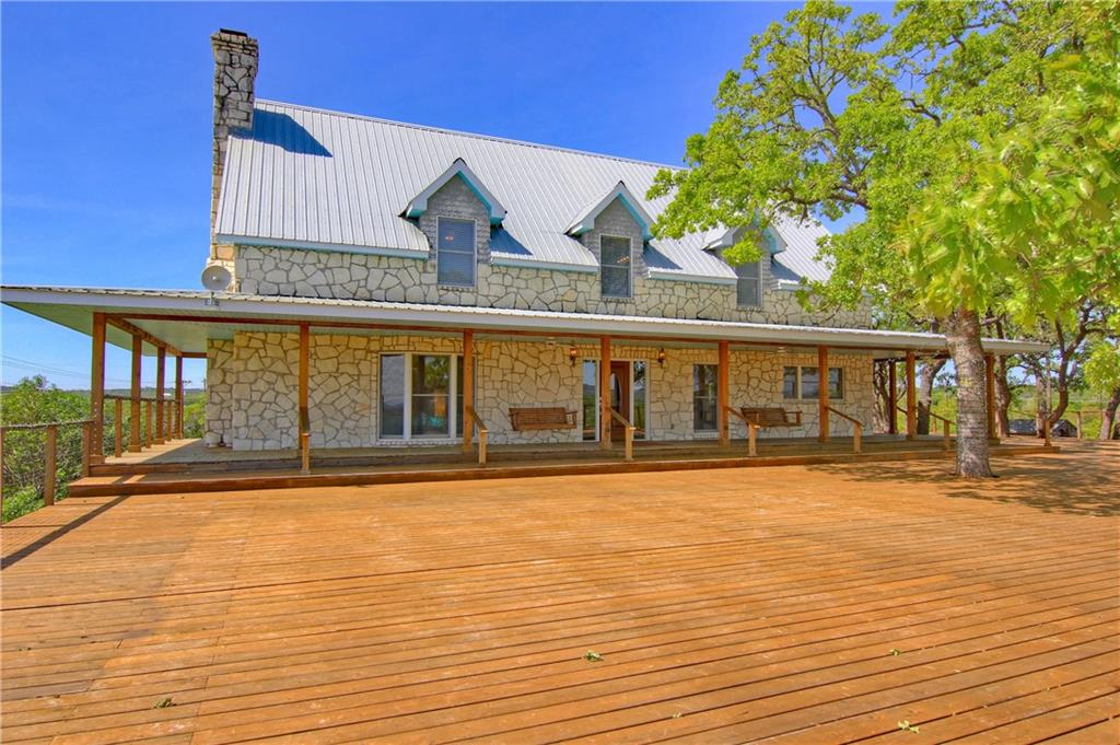 Amazing 52+ acre ranch 15 minutes East of Marble Falls and 35 minutes Wes of Cedar Park with NO restrictions!  This respected Hill Country property is currently used for wedding/event venues, corporate retreats, and family vacations.  6,500 sf barndominium (offices or living quarters & 3,000 sf event barn); 4,143 sf house 5 bedroom 3 bathroom with 6,000 sf deck & fabulous views; 2,784 sf house 3 bedroom 2 bathroom; most furniture conveys with few exclusions;  30' x 40' tractor barn; workshop; rustic cabin; 3 wells; 3 septics; wet weather creek with waterfalls; and, so much more!  Ask for full list of features.