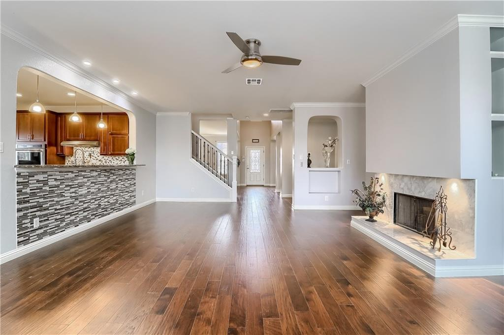 Well-appointed, updated home with an impressive Gourmet Kitchen. Custom cabinets with soft close drawers, granite countertops, Stainless Steel appliances and a double oven! Gleaming hardwood floors and custom tile throughout living areas on main level and upstairs. Dedicated Office space at back of the home and potential for another office space on main floor. Recessed lighting in Kitchen.  6 bedrooms (all with walk-in closets), and 4 full Baths. 2 Master suites; one is on the main floor (it is truly an en suite with its own private bonus room upstairs). The second full bath on the main level also boasts a handicap accessible full shower.  Game room upstairs.  Carpet only in 2 upstairs bedrooms and a whole house filtration system.  Extra driveway pad in front. New roof approx 2018.  This is the perfect work form home or multi-generational set up. This home is the epitome of spaciousness, you could fit a couch in every room! 4 living aras, 2 down and 2 up. Custom designed Fireplace surround with storage. 325 sq ft office mud room on back of home (mud room has plumbing for fridge).  Dog run on side of home.  Custom workshop in backyard.  Private backyard not only backs to pasture, but is gorgeously landscaped with lush rose bushes and blooming trees. Exterior of home has all 4 sides Brick.  Minutes from the new Kalahari Resort and Typhoon Texas Water Park.  Shopping, restaurants and a movie theater are just a mile away. Conveniently located minutes from Dell, new Apple campus, Amazon fulfillment Center. Minutes to 45, IH 35 and Mopac.  This home is definitely a must see, you will be hard-pressed to find anything like it. See the 3-dTour here:  https://my.matterport.com/show/?m=E5N4Ew8qKwi&mls=1