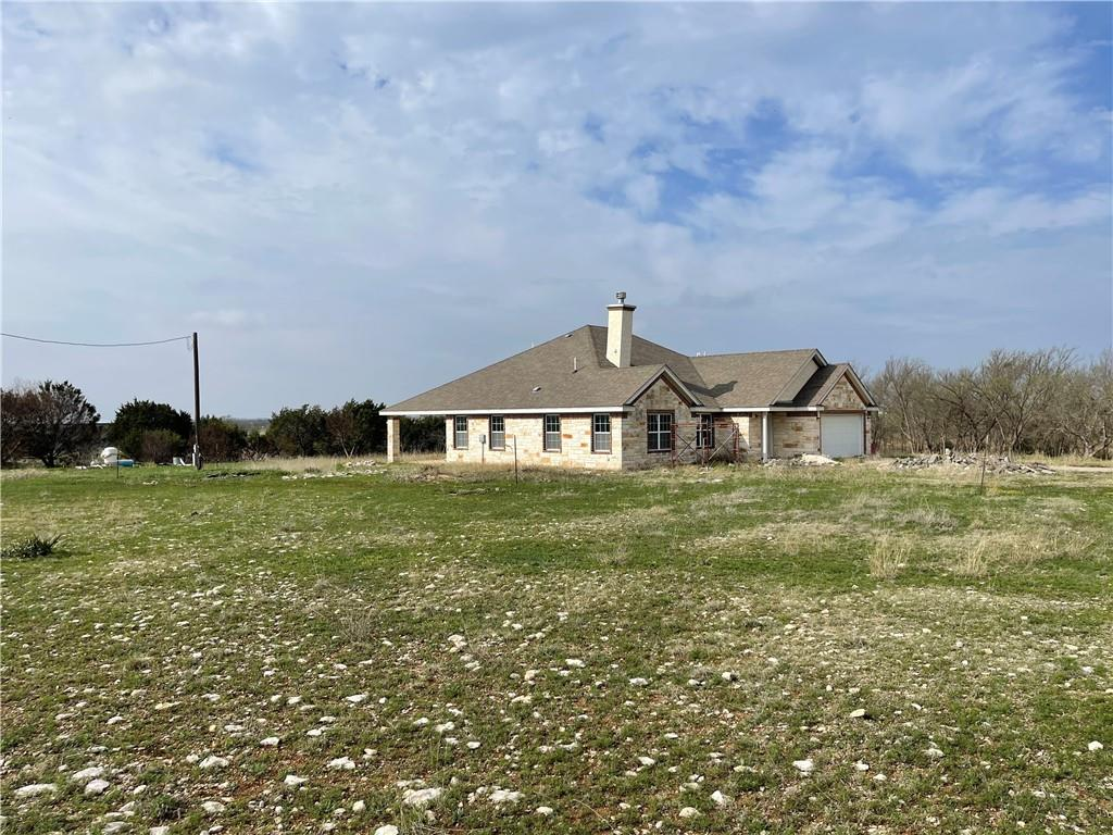 32 acres within 35 minutes of Georgetown with custom home the is 75% complete. Nice Hill Country views rolling grass and trees.