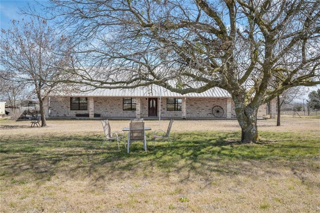 Beautiful 3/2 rock home in the country. 5+ acres.  Thermal heat pump and solar panels. RV Storage. Just north of the SH45 and SH 130 interchange. Close to Stone Hill Town Center shopping and dining. PfISD schools. Buyer to confirm zoning.