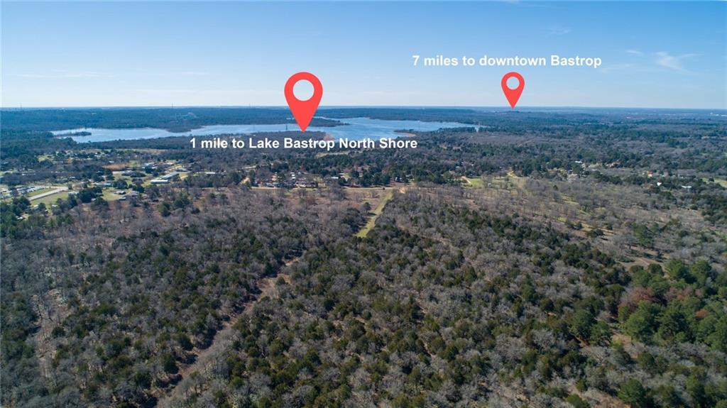 "What a great development opportunity or long-term investment to capitalize on the explosive growth in the area. This property has the desirable 1-D-1 Open Space Ag. Exemption = LOW TAXES. Only 30 miles to the new Tesla Giga Factory, 1 mile to Lake Bastrop, 30 miles to ABIA International airport, directly across the street from Lost Pines Elementary, and 8 miles to Bastrop State Park. This property has access to BOTH sewer and water, and is in the county's jurisdiction only - no city or ETJ jurisdiction. Aqua Water has a 14"" line on Green Valley Dr. and a 4"" line on Tiger Woods Dr. Corix sewer and natural gas are available as well - feasibility studies available upon request. 