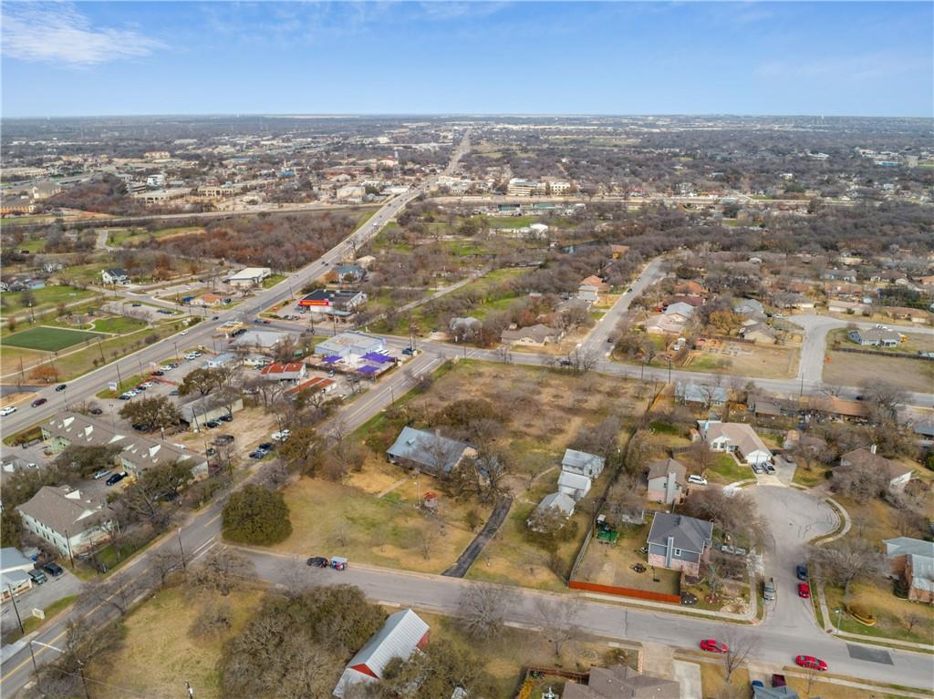 PRIME INVESTMENT/DEVELOPMENT OPPORTUNITY IN THE HEART OF ROUND ROCK - See All Documents Uploaded - RARE FIND - 2.648 level Acres, off IH 35 and only 2min from Downtown Round Rock - Rezoning Opportunities exist for MF-1 (Multifamily - Low Density), TH (Townhome) and OF-1 (General Office) - 1 AC is currently AG exempt in tax records - Road access on three sides make this site perfect for future development. Logan St is being extended to A.W. Grimes Blvd as part of the RR Transportation Master Plan.  This project will provide local residents with greater neighborhood connectivity and improved access for emergency vehicles by extending Logan Street to A.W. Grimes Boulevard.  Construction began in June 2020 and is anticipated to conclude in spring 2021. Improvements include: Constructing a two-lane extension of Logan Street to A.W. Grimes Boulevard with a bridge over Dry Branch Tributary 1 - Connecting Heritage Springs Trail to Logan Street - Adding sidewalks to both sides of Logan Street - Connecting trails to Logan Street sidewalks for improved walk-ability to the school and recreation center.  Well maintained property.  Single story home has open layout, floor to ceiling fireplace and vaulted/beamed ceiling. Kitchen provides ample storage and center island. Large Primary Suite with Spacious Primary Bath which has separate vanities and walk-in shower.
