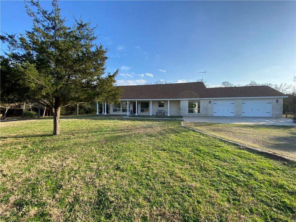 This beautiful Stone Home features stone on all four sides and a wrap around porch. It is a 3/2/2 with a mudroom or office as well. It has been remodeled and updated. It has an open floorplan, stranded Bamboo wood floors, granite counters, stainless appliances, walk in closets, soaking tub, Large walk in shower. A guest cottage and an animal Barn. The land is breathtaking it is so relaxing. Plenty of space for a garden and yet treed acreage for privacy and wildlife.