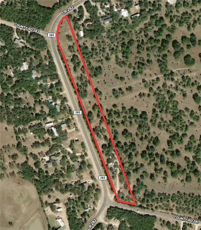4.75 Unrestricted acres of undeveloped land with high visibility on the corner of County Road 282 and County Road 281. With ~1650 ft of frontage on County Road 282, this property has great potential for commercial development or as your residential escape a little bit outside the city. The property is covered in beautiful stands of oaks and has been cleared of cedar except along the road to leave a privacy buffer. A large portion of the back of the property borders the Williamson county River Ranch County Park. You could build your house amongst the towering oak trees and go out the back gate to access 1,354 acres of gorgeous park land.