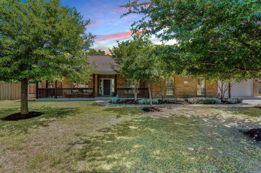 This gorgeous home in Hutto is a rare find! With 5 bedrooms and 3 full bathrooms, there is plenty of room to spread out. All of the bedrooms are on the main level except for one that is upstairs with it's own full bathroom. The home has a front dining space that could also be used as an office or flex space. The kitchen has been newly remodeled with beautiful white cabinets, updated suede granite countertops, stainless steel appliances, and light fixtures. With a great open floor plan, the kitchen opens to the family room and the breakfast nook which is perfect for entertaining. The bedrooms had carpet replaced in the fall and the house has been freshly painted. The garage offers extra space and was built to fit Texas-sized trucks! There is a separate office off of the garage that has 2 office spaces, a shared open space, and a half bathroom with an outside entrance as well. This is perfect for those needing an at-home office space, extra room for crafting, homeschool space, or so many other possibilities! The house sits on a half-acre lot. The backyard is an oasis with a small pond, lots of lush greenery (when a winter storm hasn't hit), and a hot tub that is covered for privacy. There is also a large concrete area with a basketball court that could also be used for additional parking! This is really a home that can't be missed! Virtual Tour:  https://www.zillow.com/view-3d-home/70600fbd-ddae-4d61-bbe6-d277d28730fa?setAttribution=mls