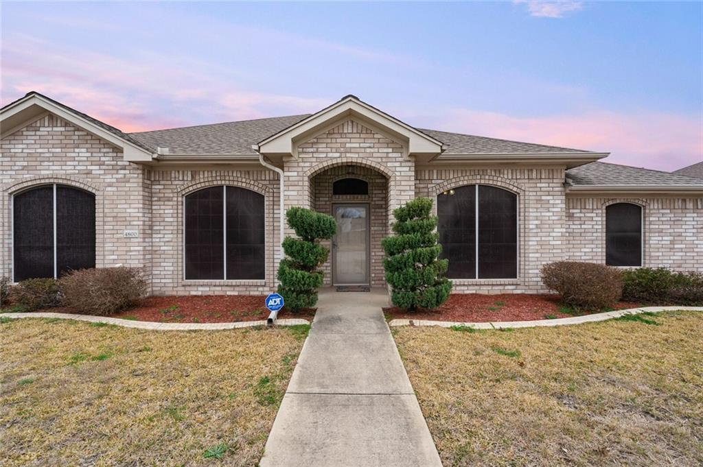 Welcome to this inviting, four-bedroom, 2.5-bath home located in the White Rock Estates neighborhood in Killeen. Walk-in and be greeted with the formal dining area and a bonus office space with a french door entry. The open floor plan living area has tray ceilings, wood-look laminate flooring, and a wood-burning fireplace with a mantel. The chef kitchen features granite countertops, a modern tile backsplash, stainless steel appliances, a walk-in pantry, bar top seating, and an island. The Master Bedroom adorns vaulted ceilings and has an attached bath with his and hers setup, jetted tub, step-in shower, and a large closet. All bedrooms have carpet flooring, and tile spans the other bathrooms. The spacious backyard has a porch, an additional raised deck, and plenty of space for kids or pets to run around. Great location, only 7 minutes from Lions Club Park and close to I90.