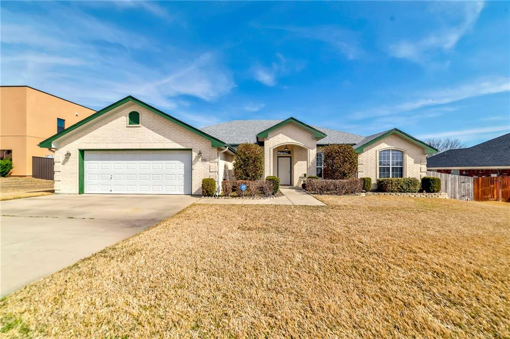 This beautiful Scott Cosper custom home with 5BR/2.5BA is for sale in Onion Creek Estates off of Trimmier, and is minutes from Post, shopping, and restaurants.  This home was designed with entertaining in mind.  The dining and living rooms can be closed off from the other rooms, and then opened up for your family and friends to mingle and visit.  Enjoy the open concept in the family room cozied up to the fireplace during chilly Texas evenings.  The family cook will enjoy the custom cabinets and the counter space in the kitchen.  All kitchen appliances have been replaced within the past few years. The master bedroom is very large and private.  Enjoy the large jetted tub after a tough day.  The master closet is located off of the bathroom.  The four minor bedrooms are a good size for your growing family.  You can sip coffee on your front porch while watching you children walk to school.  Enjoy nice evenings on your large patio with no rear neighbors.  Call today for a showing!