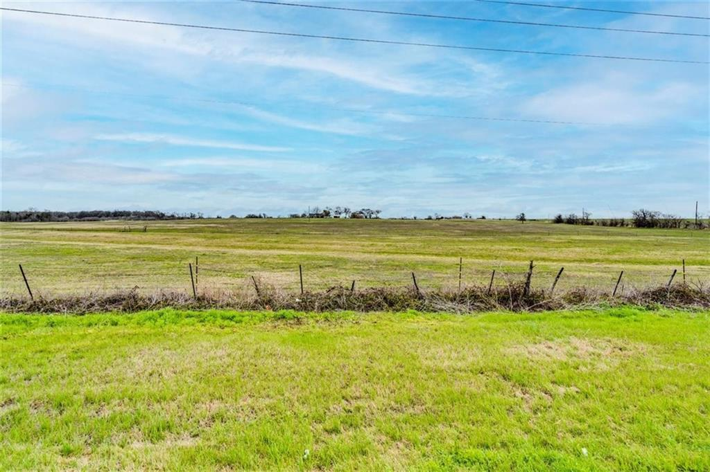 Very desirable homesite or build site - 15 Acres (being subdivided out of 64 acres) on TX 190 with no restrictions. Improved hay field to maintain agricultural exemption. Approximately 716 feet of road frontage on TX 190.
