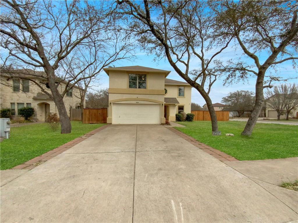 This Leander two-story cul-de-sac home offers granite countertops and a two-car garage.