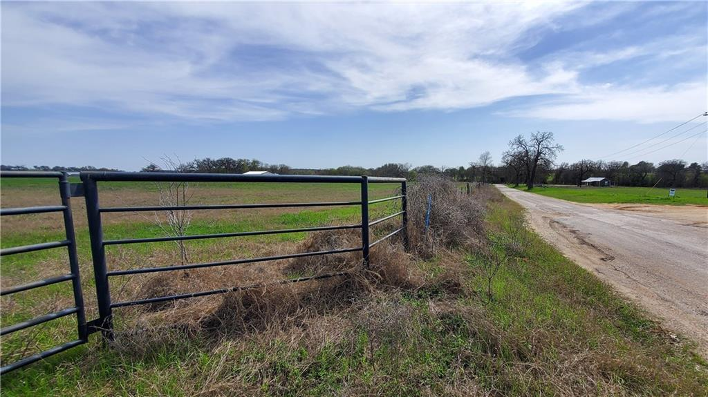 Watch the sun rise in the east and set in the west in this 20 acre tract located in Milam County just minutes out of Rockdale. Highway 79 offers a direct commute to Round Rock/Austin. This beautiful land is an open meadow & has a pond for wildlife or livestock habitat. The soil on the property consist of good sandy loam with improved coastal grass for an excellent hay crop. Good pasture in place and would be great for horses and cattle. The property is fenced and an agricultural exemption is in place for lower taxes. This property is mostly level and all useable and offers a great place for a homestead or future home sites. SWM Water and Bartlett Electric available.