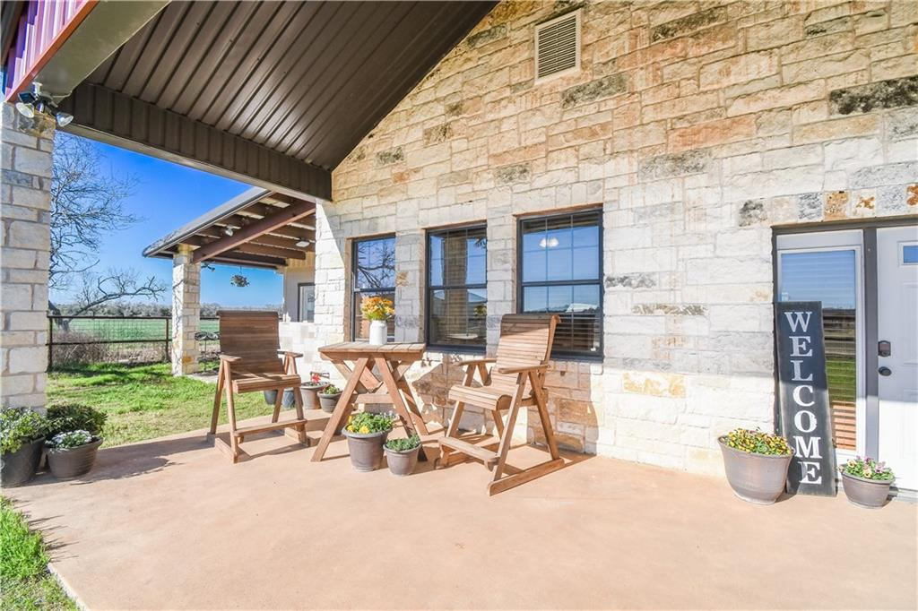 Location Deluxe! Welcome to Central Texas!!! Nestled just south of Bastrop, this two bedroom 2 1/2 bath rock home is ready for whatever your heart desires…..Enter the home and get comfy by the stone wall fireplace or enjoy making memories sharing your cooking skills in the kitchen! Features include granite counters with custom Bodark cabinets and Mesquite bar top counter. Enjoy our wonderful mild weather and entertain on the front patio but don't forget to take in all the amazing sunsets! This 29 acre property is fenced and cross fenced so bring the animals! The 62x74 foot barn has five roll up doors and one walk through. It is an open canvas to design your own horse stalls(seller will negotiate installing custom stalls) or work bays for the car gurus! Inside you will find a 14x 20 storage which can be a tack and feed room if so desired. Additional features include cattle pens with a concrete workstation, 7 acres planted in oats, sand brought in for ideal riding area(not currently fenced but would do so if negotiated), swivel tie racks, and ponds! Light restrictions allow for additional site-built homes and guest homes. Major metroplex's include Austin, San Marcos, San Antonio, and Houston. Easy commute to Austin-Bergstrom airport or the newly announced Tesla!Additional acreage available.