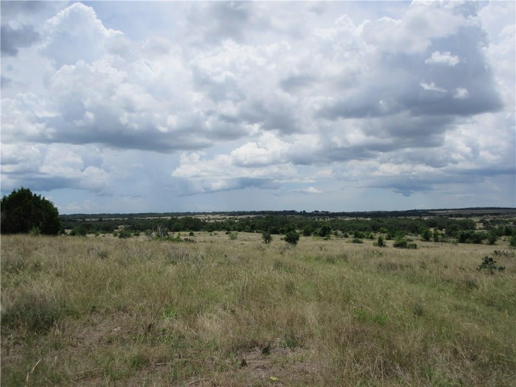 Long and wide southerly views from the high point on this unimproved acreage tract. Seller to impose minimal deed restrictions at closing. 46.91 acres of mostly cleared ranch land. BIG, UNOBSTRUCTED VIEW and a variety of native trees! Ranching, hunting, and residential potential on this private tract. Listing agent must attend all showings for access to property and provide 6 person UTV.  Subject property is near Franklin DR off Hugo RD. IS NOT Franklin RD on western edge of city of San Marcos.