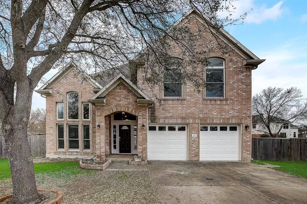 This Round Rock two-story cul-de-sac home offers a patio, granite countertops, and a two-car garage.