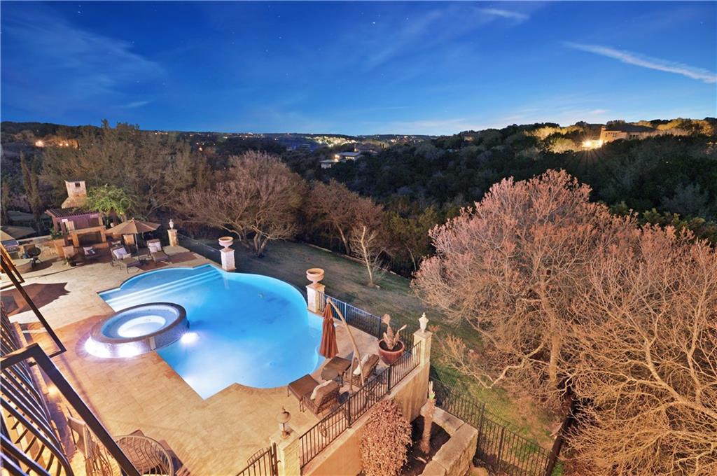 The CROWN JEWEL of Arbolago! An exclusive oasis on +/-1.78 acres that overlooks a vast greenbelt and hill country VIEWS. Lake living at its finest, homeowners will enjoy the SERENITY of the rolling hills with evening breezes on the covered veranda and the lake just a short stroll away. Grab your paddleboard or kayak and head down the meandering path that leads directly to private lake access where you can fish, boat, swim and enjoy the LAKE life! The house features FOUR outdoor covered living areas as well as a hotel-worthy pool and multiple areas for outdoor dining and entertaining. Enjoy the lap of luxury all year long with 4 fireplaces to keep you toasty in the winter and a SPARKLING pool with a negative edge hot tub to cool you off in a Texas summer. The GRAND foyer both welcomes and impresses. With a sweeping staircase, 2-story ceiling, and a view of the formal dining and living rooms, guests and owners will both delight in the opportunity to enjoy a fine meal or a casual gathering in a quiet setting. The kitchen, family, and casual dining rooms are united into 1 large space. Adjacent to the kitchen, enjoy a wine storage room and a butler's bar with two wine refrigerators. Grill burgers with the built-in gas grill on the covered veranda or take the gang down to the pool for an even more spacious summer kitchen. The dreamy owner's retreat is on the main level and overlooks the VIEWS and POOL! Ample space for a sitting area, huge bed, and a peaceful night's slumber. Private office with custom built-ins is located near the owner's retreat and is ideal for a work from home opportunity. Main level also features a large guest bedroom with on-suite bathroom. Upstairs, 3 additional spacious bedrooms each offer walk-in closets and on-suite private bathrooms. The upper level also provides a secondary family or game room with fireplace and its own private covered balcony as well as a media/bonus room. LOW tax rate of only +/-2.1% saves HUNDREDS each month!