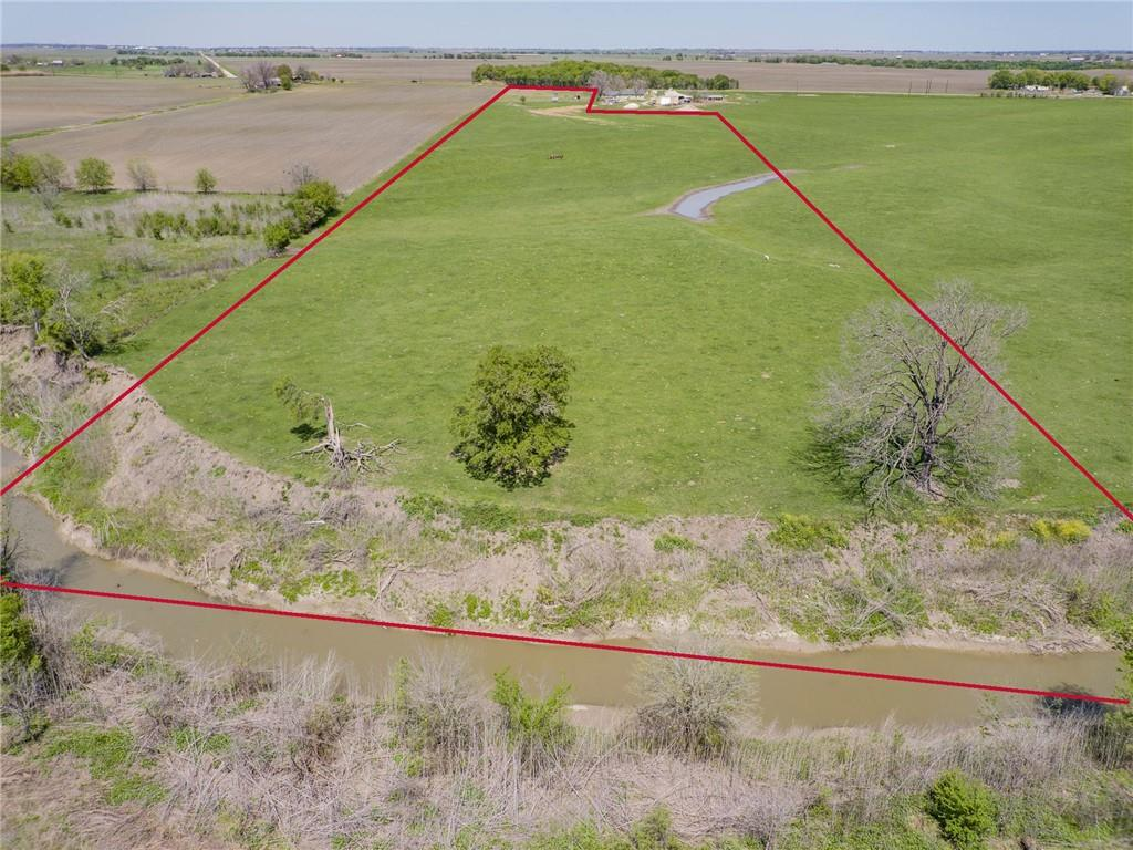 Fabulous 15 stunning acres with frontage on FM 112 in highly desired Thrall. Exceptional schools and community...enjoy peaceful country living with proximity to Taylor shopping, restaurants and fabulous downtown and easy commute via 79, 95 and toll road 130.  15 gorgeous acres with creek, amazing trees and outstanding homesite. Generous frontage on FM 112 and one of a kind home site, AG exempt and amazing country views...