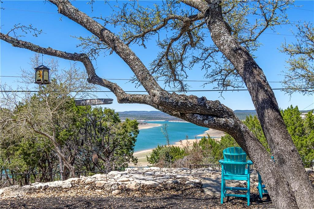 Awesome Panoramic Lake Travis Views!  Remodeled 1 Story, No Stairs, Open and Unique 3 BR Home on over 1/2 AC Lot - Over 150K+ in Improvements - Exceptionally Huge Family Room with 2 New Double Sliders leading to Private Backyard - Soaring Wood Beamed Cathedral Ceiling - Crown Molding - Chic Fireplace with Deco Tile - New Hardwood Look Tile Flooring, NO carpet - Shiplap Walls - 3 Large Gorgeous Remodeled Bathrooms - Updated Kitchen with New Quartzite, New Farmhouse Double Sink, Custom Tile Backsplash, Black Leathered Granite Breakfast Bar, SS Appliances - New Modern Front Double Door - 3 New Barn Doors - Master BR Suite with Slider to Patio and Hot Tub - Master Bathroom with Large Walk Through Shower & 2 Shower Heads, Floating Sinks and Custom Mirror Sliding Doors. You will enjoy Lake Views from almost every room - Oversized 2 Car Garage with Separate Workshop  - Driveway large enough for Boat or RV Parking - Gorgeous Live Oaks - Extensive Xeriscaping for Ease of Maintenance - Fenced Yard - Fire pit - New Hot Water Heater, New Air Compressor, New Grinder Pump - New Ceiling Fans - Too many updates to list here! ***Owner Licensed Agent!  PREFER APRIL CLOSING & 3 MONTH LEASEBACK TILL MID/END JULY