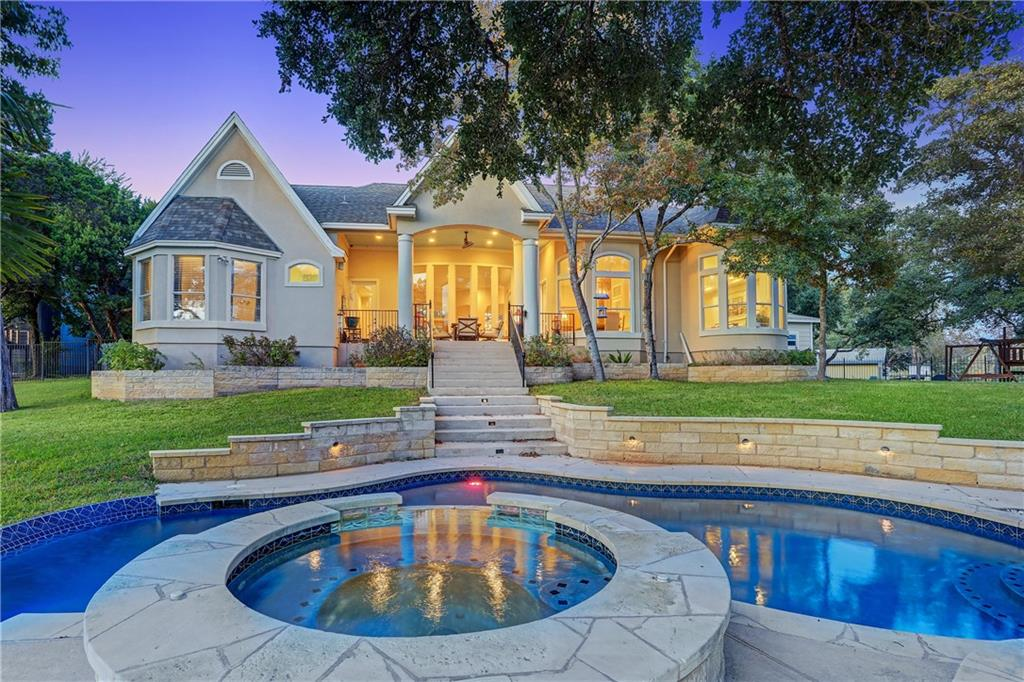 Gerogous home nestled on a tree filled waterfront lot about 30 minutes from Austin.  As you enter the home you will be impressed with the views and the soaring ceilings and massage windows.  Each bedroom in this home is large and most have a view of the water.  The pool/spa and backyard in general will be the place to be this summer for all your parties, family gatherings and is a perfect place for weddings! No restrictions here since it is outside the city limits.  Outside at the bottom of the lot you have your own private covered patio with an amazing view of the lake and another BBQ pit and fire pit area.  Next to that space but seperated by stunning trees is a Zen rock garden that is alos a tranquil place to just be.   Back inside, the main home has 3 large bedrooms and a flex room that can be an office or a bedroom, we are using it as an office now.  3 full baths in the main house give you plenty of oppourtunities to host a large number of guests.  The kitchen, two dining and living area are all open and a perfect space to entertain.   The master bed and bathroom are a destination....make sure to check them out!  In the hallway to the spacious garage that has a workshop/space area is a door that leads to a huge over the garage storage area now but more importantly you can check out the space that could be finished out later as a second story which would make the total property square footage exceed well over 6000 square feet. The guest house can be used as a seperate living quarters since it comes with its own kitchen, bathroom, livingroom, 2 bedrooms (one without a window) as well as laundry hookups in an unfinished mudroom on the way to the 1 1/2 car garage.   Make your way down the path to the private boat dock.  Please note, new steps have been ordered and paid for that are wider and 40 feet long so they will extend into the lake and allow the boat dock to become self adjusting depending on the lake level. Truly a hidden gem.
