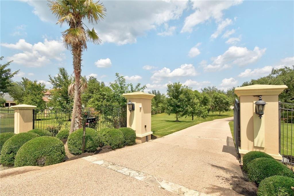 """This Estate is a rare find for a car enthusiast with a 4 bay oversized garage and space to build another 3-4 car garage.  Custom built with beautiful architecture and impeccable craftsmanship. Well sited on a 3-acre estate in an acreage subdivision in west Austin's """"Land between the Lakes"""" with Lake Travis and its world-class clear blue water, marina's and restaurants steps away, and Lake Austin access within 10 minutes you can have an adventurous lifestyle on both lakes. The main house features 5 bedrooms, 4.5 bathrooms and is loaded with large windows for a bright cheerful home. The gourmet kitchen opens to the large family room that boasts a floor-to-ceiling stone fireplace and stunning views drawing you to the resort-style backyard, with a large covered patio, gorgeous pool complete with water features, and surround sound music, completes the oasis.  The Master Suite with a spa-like bath is positioned to take in all the views.  All secondary bedrooms are oversized with private bathrooms.  The guest quarters are located on a separate wing, allowing for privacy. Minutes from the beautiful Lake Travis to restaurants,  boating, sailing, fishing, and so much more."""