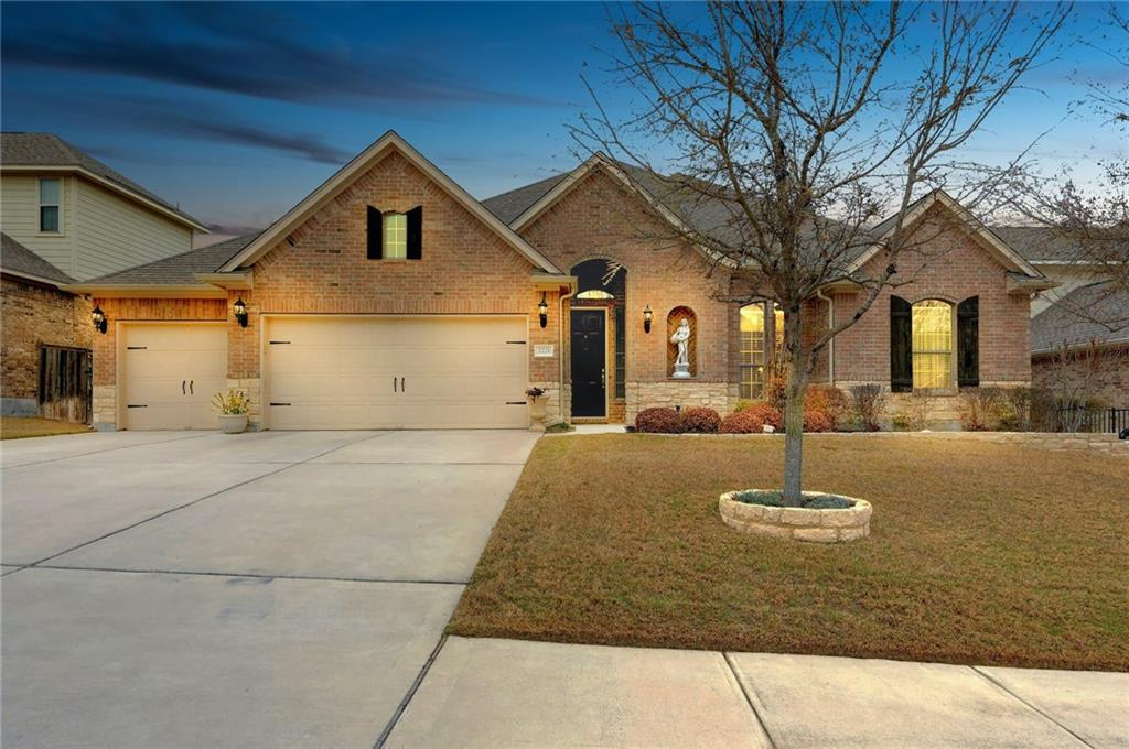 Tremendous curb appeal are found in this gorgeous, all brick and stone single story home in Crystal Falls. Meticulously cared for by the original owners with builder and owner upgrades throughout. This spacious, open and efficient floor plan fits today's lifestyles with 4 bedrooms and 3 full bathrooms and features a dedicated office and 2nd living space! The kitchen features striking granite with a tile backsplash and a large breakfast bar. Generous sized primary bedroom with tray ceiling, wood flooring and extra roomy ensuite bath with tile surround soaking tub and tiled walk in shower with seat. Two large closets top off this gorgeous primary bedroom. Two secondary bedrooms with nice sized closets are perfectly located in the floor plan for accessibility and privacy. A third secondary bedroom features direct access to the third full bathroom. The living room includes a gas fireplace, coffered wall treatment and is wired for surround sound audio speakers. Beautiful living extends outside with a patio featuring a gas stub out, ceiling fan and pre-wired for audio speakers. A garage for today's active lifestyles includes 3 - bays, two bays accessed with the main overhead have epoxied flooring, the single bay has a workbench and cabinetry, loads of storage — attic is fully decked and includes a radiant heat barrier. Strong area amenities allow residents to enjoy multiple community pools, disk golf course, playgrounds, tennis court and  crushed aggregate walking — running - biking trail. Information deemed reliable but not guaranteed - Buyer should verify all information.