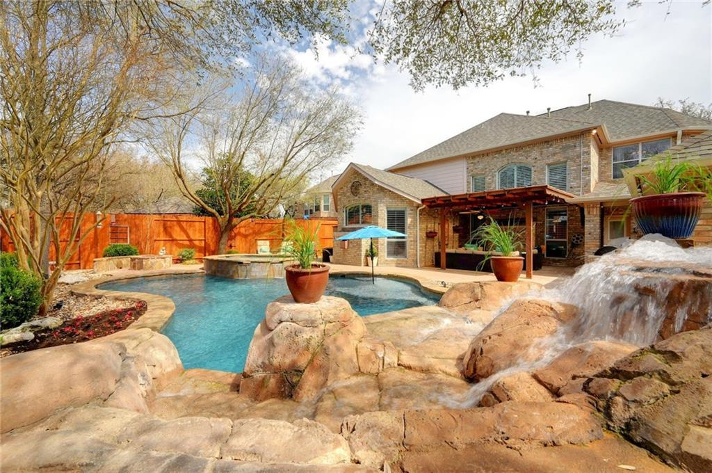 """Multiple offers received. Beautiful home with soaring ceilings located on Cul-de-Sac street in Behrens Ranch. The exterior features Country French brick with cast stone accents, a porte-cochere and detached 3 car garage. The backyard has gunite swimming pool, large hot tub, fire pit and water fall with swim up grotto.  Inside you will find soaring ceilings at entry & great room with a dramatic stair case.  The kitchen features SS Monogram appliances with a 48"""" range (4 burners, griddle grill, double ovens), 48"""" hood vent, Advantium microwave, granite counters, under and over cab lighting & more. The master bath is impressive with large mudset tile shower, 1/2"""" frameless glass, free standing tub, recent fixtures, granite counters and the most amazing closet organization system in Behrens Ranch.  Recent updates include carpet/hardwoods (2021), XC21 SEER multi speed HVAC, roof 2018, smoke detectors 2020, fixtures. Tons of smart home features. Kids attend the 3 best schools in Round Rock. Amazing Behrens Ranch amenities and low City taxes (No MUD)."""