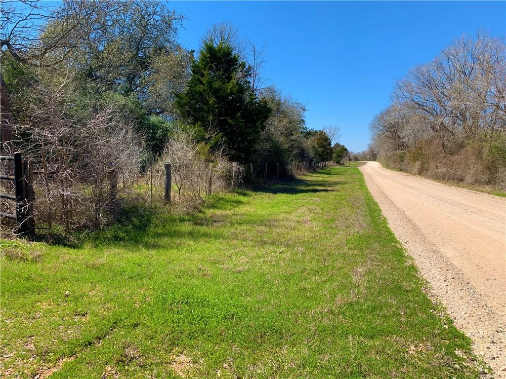 127 acres of country paradise! This is the place that you have been waiting for and this type property doesn't come on the market very often. Rolling hills covered with Live Oaks, Post Oaks, Yaupon, Cedar and Mesquite. Seasonal creek and opportunities for ponds are present. Improved roads and cattle guards throughout the ranch. This place has a great mix of open grazing as well as wildlife cover which make a great mix for raising cattle, as well as hunting. Deer, turkey, pigs and dove are present and waiting for your weekend getaway. Living quarters, out buildings, water well, septic and electric are all in place. This turnkey opportunity only leaves one thing missing, and that's you!