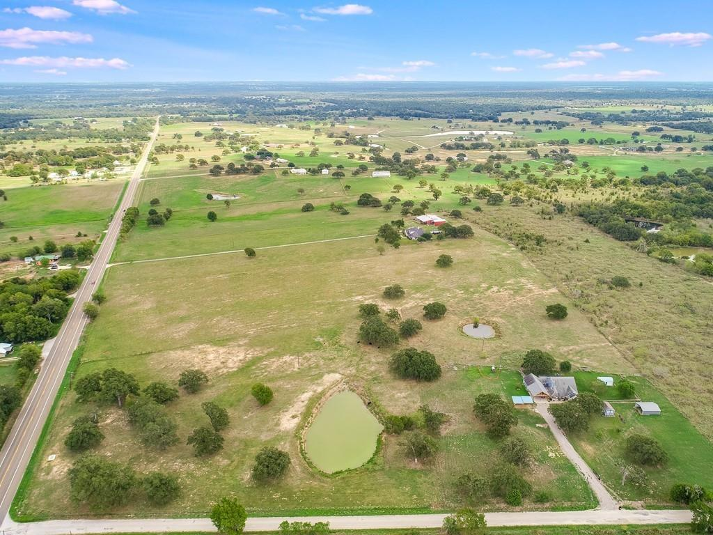 14.27 Acres at FM 696 and CR 308 in Lexington! Nice oak trees. Improved pasture with pond. Property is fenced and is currently AG EXEMPT. Build your dream home. Water and electricity are available in the area. Septic needed. Deed restrictions.