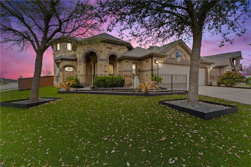 Located in San Marcos is this beautiful two-story, four-bedroom, 3.5 bath home in the Riverbend neighborhood. This property holds amazing curb appeal - The front yard features a forever green lawn that requires no water or maintenance of any kind for your convenience! Upon entry, find a foyer with an intricately detailed dome ceiling and access to the formal dining room, which could also serve as the perfect home office. The spacious open concept living area has large windows that allow ample amounts of natural light, recessed lighting, and wood flooring. The kitchen features beam ceilings, granite countertops, tile backsplash, and a counter for bar top seating. You will find tray-ceilings in the master bedroom, a walk-in closet, a full bath with a double vanity, a step-in shower, a garden tub, a bidet, and ample storage space. Head upstairs and find the additional bedrooms, a back porch, and a family room with a bar-kitchen combo; The perfect space for entertaining. In the back, you will find a covered back patio and a large yard.  Great location across the street from Blanco Vista elementary school and minutes from Five Mile Dam Park and I35 access.