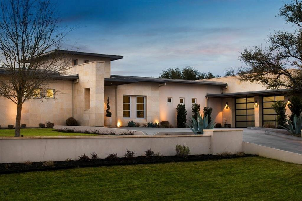 Immaculately designed 1-story home + detached guest quarters in the gated community of Verano in Barton Creek, just 15 minutes west of Downtown Austin. Built by Trella Homes in 2014, this modern resort-style home features custom white oak & natural stone flooring, a gracious, open floor plan that transitions seamlessly to the serene outdoor entertaining areas. Floor-to-ceiling windows capture the hill country setting backing to the picturesqueBarton Creek preserve. Fully equipped with today's finest luxuries, features include stainless Viking appliances, a wet bar with ice maker, built-in wine chiller, bright office/study near entryway, formal living featuring double-sided fireplace, Chef's kitchen with adjoining butler's pantry, well-equipped mud room. Each bedroom is spacious and features an en suite bath. Additional amenities include solar panels, central vacuum system, double-ovens, built-in convection & microwave oven, water softener. Detached structure features large flex space and private-entry guest suite with full kitchen & bath. For the utmost in outdoor life, this property also features glass collapsible doors invite the outdoor oasis in - complete with fully automatic screened drop-down shades allowing youto enjoy the outdoor breeze without the bite, stunning pool & spa with waterfall features, a built-in outdoor Viking grill & griddle, outdoor shower, and fireplace. 3-Car garage + workshop on .86 acres overlooking the tranquil hill country. Main Home: 5 Bed | 5 1/2 Bath 5,616 +/- SF Guest House: 1 Bed | 1 Bath + Kitchen 1,081 +/- SF Austin ISD: Oak Hill, O'Henry, & Austin High Schoolswith great proximity to Austin's top private schools!