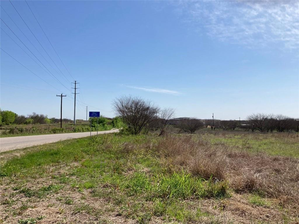10.45 acres For Sale and ready for development. Raw land, no building on property. Hays county #R148461 is 4.87 acres & Comal county #71515 is 5.93 acres (per tax records) Easy access to IH 35, level topography, San Marcos ETJ with 197 ft of road frontage. Excellent tract near commercial and residential developments. Water line at road, septic needed. Sign with address 7171 will be viewable from road. See agent for Land Use restrictions.