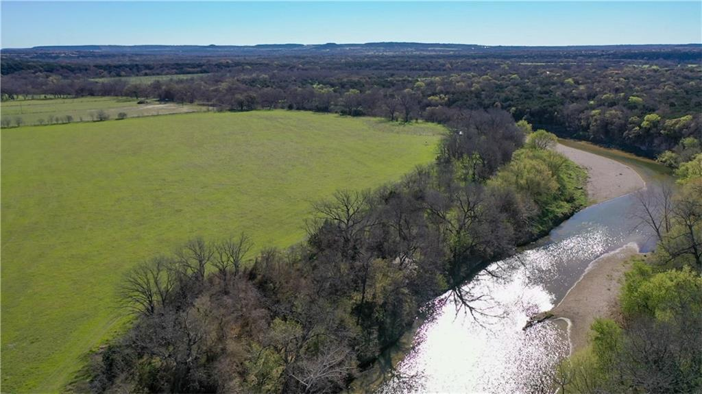 Beautiful 35 acre Lampasas Riverfront property that has appx. 1975 ft. of Lampasas River Frontage.  Relatively flat this acreage has potential for running cattle (has pens and corrals in place already) or hay production which is what it's used for currently.  With a considerable amount of river frontage this tract is ideal for recreational purposes such as whitetail deer, dove, turkey, hog hunting, and let's not forget about the fishing.  The river frontage has a rock beach that is the perfect setting for those long summer nights with a fire and friends fishing the river.  Don't miss out on this fantastic riverfront property!