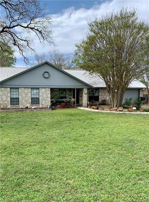 ½ Acre lot with 2000+ sf home. Low Tax rate of 1.8%. NO HOA.  Well cared for home that was remodeled by a builder as their private residence. Workmanship & quality is a higher level.  Open floor plan, 3 bedroom with study. Study has built in bookshelves and closet, so easily could be a 4th bedroom. Family & dining room have beamed vaulted ceiling. Living room has a full wall of natural stone with wood burning fireplace. Custom designed kitchen with native pecan cabinets, under cabinet lighting and pantry. Master bedroom faces back yard and has full bath and walk-in closet.  Beautifully landscaped yard.  10 x 20 Workshop with separate electric panel.  Excellent location - less than 5 minutes to I-35, 130 & 183. It is about a 20 minute commute to the new Tesla plant.  Mopac is only 10 minutes away