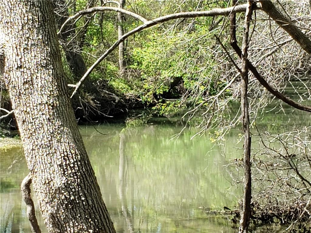 Amazing waterfront opportunity!  Rare San Gabriel River frontage (approximately 485 frontage feet) with 11 total acres of beautiful freedom.  Gorgeous mature oaks & pecan trees and natural rock ledges create an inviting riverside retreat.  Less than an hour from the city, perfect for telecommuters who want the peace and quiet of nature or a wonderful weekend family destination.  Property is AG exempt and could also make a great property for hay in the front and river in the back! Seller to require deed restrictions included in sale that prohibit land from being further subdivided to protect the country feel of the area.  Seller has purchased water tap from Southwest Milam Water Corporation that buyer can transfer upon sale, which is a pretty great deal, so no wait list. Electricity available nearby. No major restrictions and no HOA.  Great neighbors, including friendly cows that come to the fence to greet you.  Thorndale is a great community with lots of cozy hometown charm.