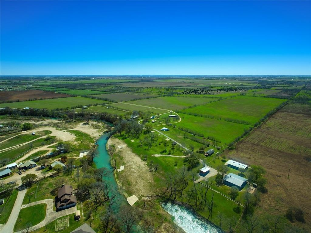 NEW RANCH LISTING NEAR SAN MARCOS TEXAS! RARE RECREATIONAL RANCH WITH APPROXIMATELY 234 AG EXEMPT ACRES ON THE SAN MARCOS RIVER! FEATURES INCLUDE: FARMHOUSE, EVENT/CONCERT STAGE, CUSTOM PALAPAS OVERLOOKING THE RIVER, BARNS AND ADDITIONAL IMPROVEMENTS! EXCELLENT OPPORTUNITY FOR EQUESTRIAN RANCH, WEDDING VENUE, CONCERT VENUE, BED & BREAKFAST & FUTURE DEVELOPMENT OPPORTUNITIES! ABUNDANCE OF WILDLIFE CREATES GREAT HUNTING ACTION FOR A TRUE HILL COUNTRY FEEL! GREAT LOCATION ONLY MINUTES FROM SAN MARCOS AND THE SAN MARCOS AIRPORT! LAND CURRENTLY USED FOR HAY PROUCTION! AMAZING LONG DISTANT VIEWS FROM HILL TOP THAT CREATES A GREAT SPACE FOR A HOME SITE! CALL AJ TODAY FOR A PRIVATE TOUR!