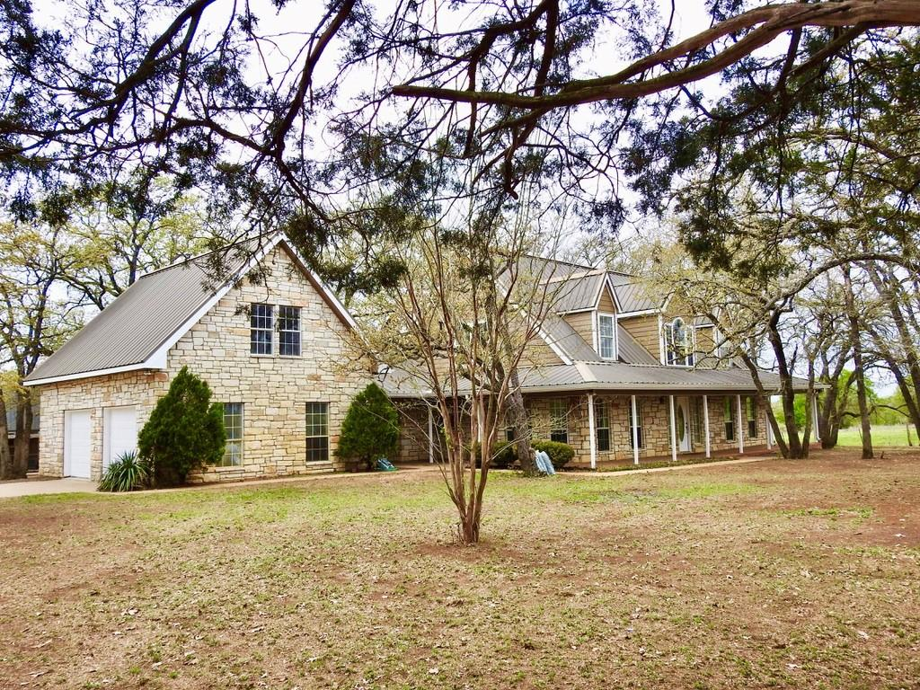 Beautiful 2-Story Home with 3 Bedrooms, 2 full baths and 2 half baths, located on 40 acres in an exceptional country setting! Long Private driveway with two fences leading to the home. The home has all new flooring throughout, and fresh interior and exterior paint! Game room above garage has a sink and half bath and Pool Table conveys. Primary bedroom is on the main level with a view of a large pond in the back. The remaining 2 guest bedrooms are upstairs. Home includes central vacuum for your convenience! The property also has three other buildings on site - Workshop with many tools and other items inside conveying, there is a chicken coop/bird aviary with chickens (and eggs, of course), and another building currently used for brooding and incubation. Property also has two ponds, two wells and corral for livestock. The livestock also conveys if interested. This is a functioning Ranch...just bring your boots and settle in!