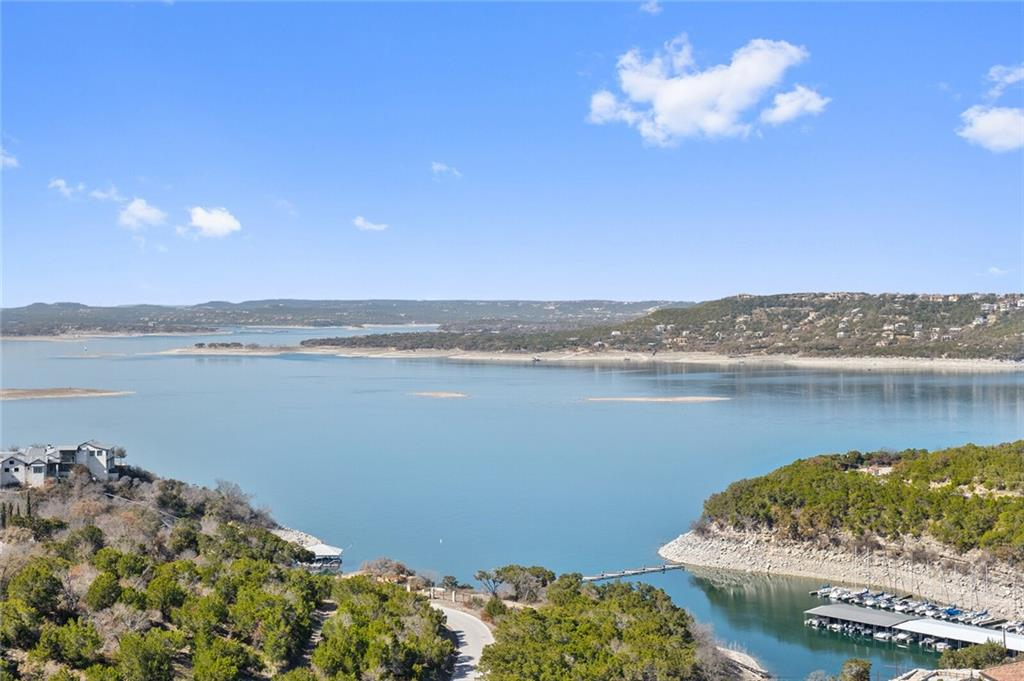 """""""The Kings Ridge"""" -PRICE IS PRE-REMODEL - """"AS IS."""". Lake Travis' most desirable diamond in the rough!  This property features some of Austin's most spectacular Lake Travis views from almost every room.  Turn it into your own jewel or utilize the Trella Homes remodel plans which convey with the sale.  This one-of-a-kind property is being sold """"As Is"""" until May 31st when demo will begin and price will change to the post construction price.  Worth the trip just to see the views! This is a down to the studs remodel. Initial listing is for current home AS IS with plans, engineering and look book. Home features unobstructed, panoramic viewsof Lake Travis, Marshall Ford Marina, Tom Hughes park and surrounding vistas; visible the moment you enter theproperty from both the main and lower level of the home. 4 bed, 3.5 bath, 3 car garage* home lives like a one story. (Renderings, """"look book,"""" photos of the current home at website.) Main level features lake views from master suite, master bath, great room, dining, kitchen outdoor living/dining, and even the utility room.The upper level outdoor living space includes a deck with area for entertaining, outdoor kitchen and hot tub/spa. The home also featuresawalk inpantry, separate laundry room with office and wine storage as well asa 3 vehicle garage and driveway parking. The lower level also features beautiful lake views and offers many opportunities for uses as a guest quarters, office, gym, game room or entertainment area. This space is an open concept area that includes a sleek kitchenette/bar, full bath, storage space/closet and private deck. .9 acre hillside lot The existing home was inspected and approved by a structural engineer last year. TCAD square footage at 3414 No HOA - voluntary neighborhood association (annual dues for road upkeep) *currently 2 car garage, 3 car garage after remodel"""