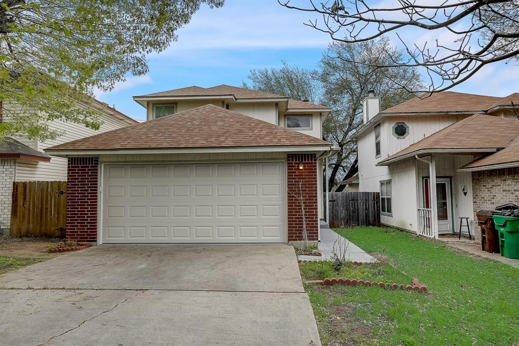 This Round Rock two-story home offers a patio, granite countertops, and a two-car garage.