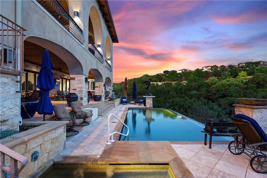Experience this home of exceptional quality located on a secluded Lake Travis Peninsula, in the exclusive gated Water Front neighborhood.  Homeowners have access to numerous golf courses, including prestigious Spanish Oaks, as well as the World of Tennis, and enjoy the Lake Travis lifestyle with rentable boat slip access at Rough Hollow Marina. The inviting entry to the property features a cobblestone circular driveway and multi-tiered fountain.  Inside are exquisite details such as hand carved Cantera Stone and intricate ceiling details.  Every room has a unique custom ceiling from coffered-wood beams, tray beams, varying millwork to arched dome ceilings and skylights. Many surprises such as an oval Breakfast Room surrounded by walls of windows to take in the expansive views.  A Wine Tasting Room and separate natural stone wine cellar with 2000 bottle capacity.  Every room is a masterpiece.  The level of finish out in this home must be viewed in person to appreciate. 8052 square feet presents six Bedrooms with nine Bathrooms plus an impressive 2000+ square feet of outdoor living with spectacular views of the lake and hill country.  The home overlooks a private cove on Lake Travis with the Pool/Spa/Sauna reaching the cliff's edge of the property.  An exterior staircase leads down to the waters edge. Panoramic lake views can be taken in from patios on both levels, each with their own outdoor Kitchen.  The outdoor Living Room is a cozy sanctuary with a stone Fireplace. A poolside full Bathroom includes a Steam Room. A separate terrace off the backyard features a Fire Pit with lake views. Two Master Suites with the most beautiful custom Bathrooms are a must see with floor to ceiling stone details. All of the extras you would expect are included in this home such as a Media Room, multiple Living Rooms, Exercise Room, Three Fireplaces and thoughtful details such as an Elevator and Laundry Rooms on both house levels.  Experience the vast amenities of 36 Water Front Ave.