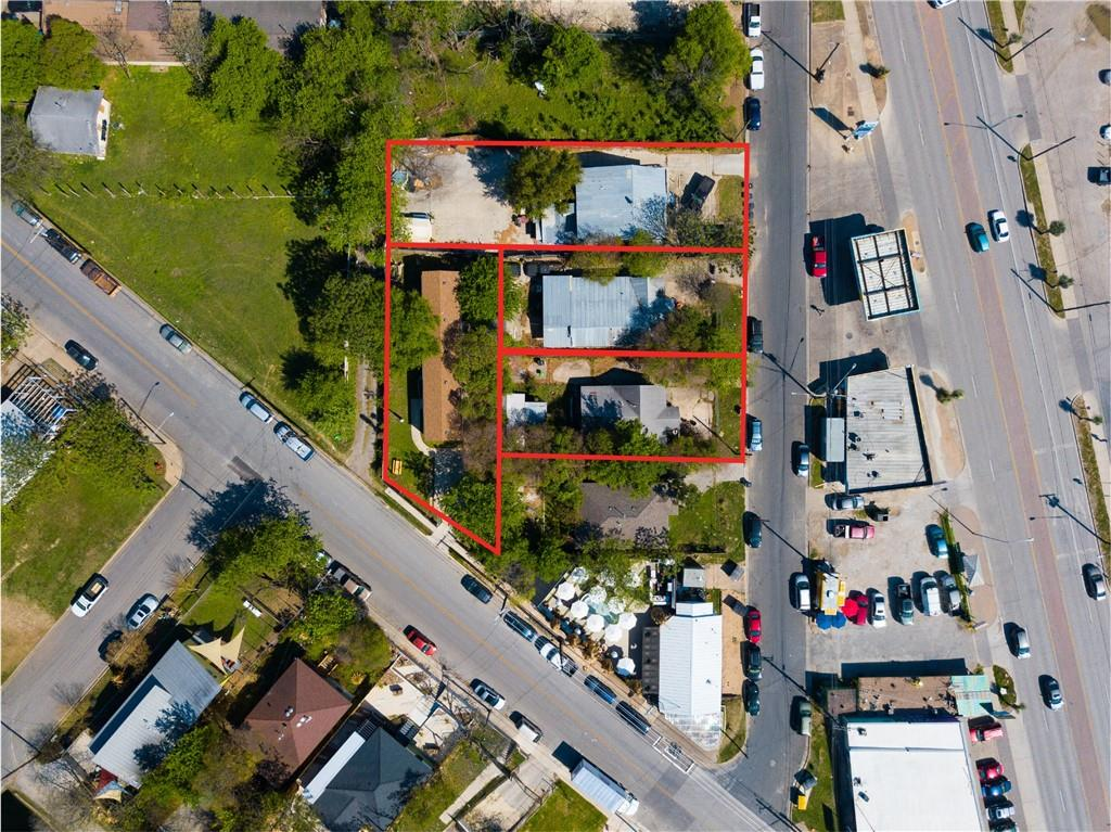East Austin find has almost direct access to 7th St. CORNER at Webberville, by 7th St on Morelos. ACCESS both both streets. DO NOT DISTURB TENANTS, Pls.  NO Showings.   FOUR adjacent properties of .5126 Ac per TCAD & combined 5784sf per TCAD, SOLD ONLY together (Do NOT Disturb Tenants) No Showings: 2312 Morelos St MUST be sold with 2304 Morelos St , 2308 Morelos St  & 2237 Webberville Rd  - All 4 properties are currently leased, 3 on month-to-month basis : 2312 Morelos ($2300/m0); 2308 Morelos ($1200); 2304 Morelos ($1300/mo); 2237 Webberville ($1800/mo)    Survey only of Webberville property.