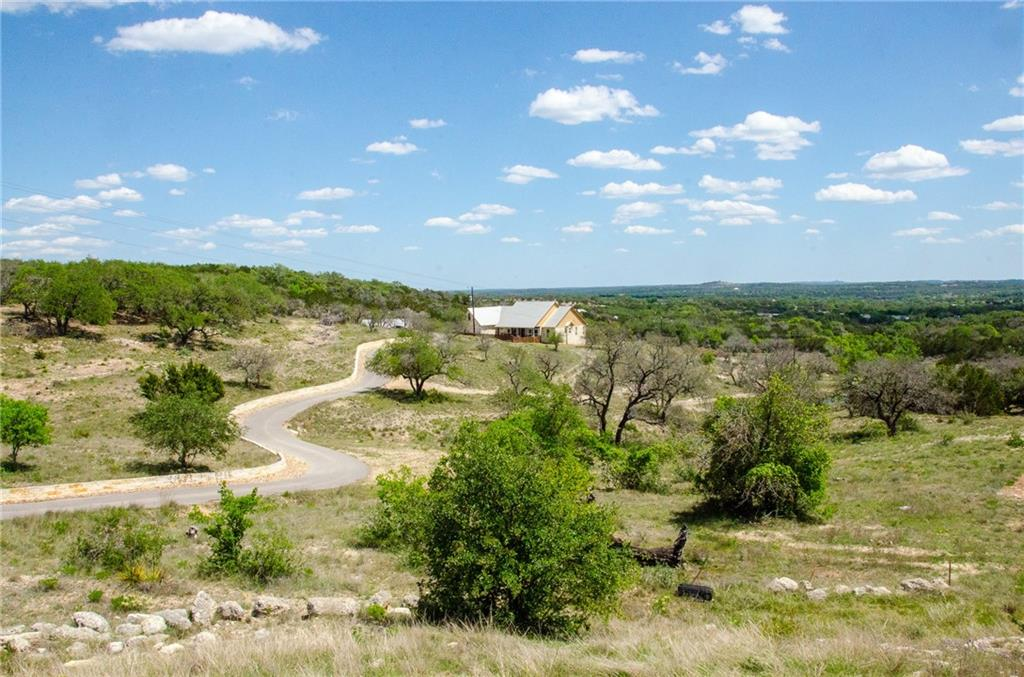 This highly desired property is comprised of 27.18 acres in a cul-de-sac, a beautiful home, fantastic views and in the acclaimed Dripping Springs ISD! This hill country chique custom home was built just 5 years ago and consists of a white limestone exterior, standing seam metal roof and a fantastic covered deck to enjoy the amazing views! The 3 bed, 2.5 bathroom features an open floorplan with a formal dining, breakfast room and a designated study. There is ample space in the 2712 sq ft floorplan, single story, plus bonus upstairs unfinished space of 460 sq ft. A few bonus features include: A huge insulated and cooled 20x40 shop, wildlife exempt, fully fenced property with a wet weather creek, spring and small pond. The property has both a well and rainwater, a fenced vegetable garden, and a cool fire pit area! See attached features list with more info!