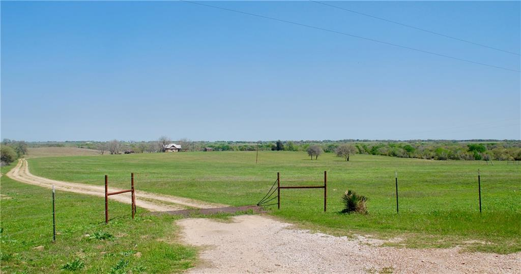 Nestled in the lush rolling hills of the Historic community of Praha is this 116.62 acres. Take a break from it all and come see the panoramic views from the back porch of the early 1900's farm house. Complete package; a large pond and 1 smaller pond, Mulberry Creek, mixture of oaks, pecan, red bud trees,  improved hay pasture of coastal Bermuda  and minerals are negotiable!! The creek provides a haven for wildlife and the property holds an agriculture exemption with a cattle lease and is fenced and crossed fenced. Spring is showing up at this property and it will be embraced with abundant wildflowers. Wake to deer grazing in the meadow below and wild turkeys calling. The surrounding areas provide great eating venues along with local winery's. St Mary's Church in this Czech community is one of the most well-known painted churches of Texas and you can see it from the hill. If you want to play on the weekends or stay for a life time come visit Praha and this special property.