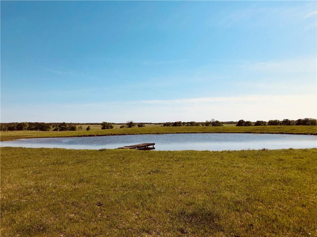 Pure natural beauty abounds at this Texas Gentlemen's Ranch! Currently being used for hay production and cattle operation, this property is complete with perimeter fencing, cross-fencing including gates, four ponds, working cattle pens, corrals, large trees, soft rolling hills and amazing countryside views. This could make for an amazing home site for new owners! Ag exemption in place. Rural water and electricity available at the street. No septic on property. Paved road frontage. Thrall ISD.