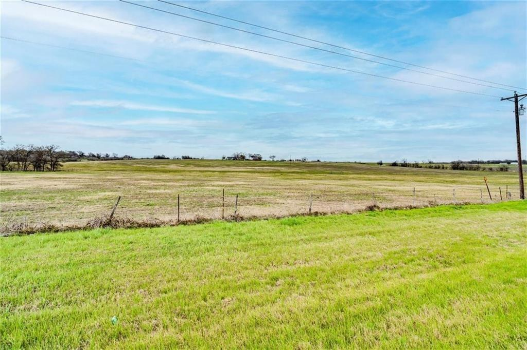 Very desirable homesite or build site - 15 Acres (being subdivided out of 64 acres) on TX 190 with no restrictions. Beautiful, large stocked tank towards back of the lot. Improved grass field to maintain agricultural exemption. Approximately 367 feet of road frontage on TX 190. Utilities are as follows: Atmos natural gas, Salem Ridge water, Oncor electricity