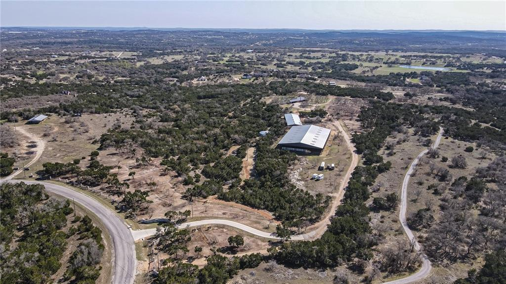 The 480 is a turnkey equestrian property located just a short drive from Dripping Springs, TX. This 28 acre property boasts a beautiful custom brick home that has 3 suites and recently been renovated. Outside you will find a beautiful pool overlooking the Dripping Springs area.There are 2 first class horse barns with a total of 18 stalls, 16 large turnouts, and a  200x125 covered riding arena. There are multiple riding trails throughout the property that weave in and out of mature live oak trees. 