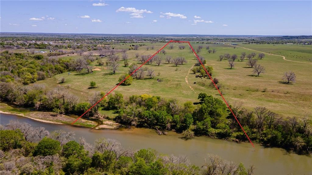 Beautiful 57.5 acres with almost 500' of Colorado River frontage located in between Bastrop and Austin. With only 5 acres being in the floodplain, this property offers many building options. The land is currently being used as a cattle lease with highly improved grasses and an accompanying water well. There are huge pecan trees scattered throughout the property that provide food for the wildlife roaming the property. There is electricity on the property and believed to have water along Wilbarger Bend. There is also an older farmhouse that could provide some beautiful lumber to salvage. Cattle on property. Do not enter without permission.