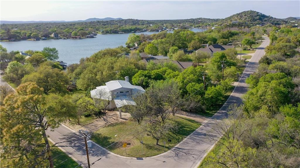 """Welcome to the Treehouse Oar'asis Retreat on Lake LBJ!"" Ultimate location w/ so many opportunities. Have fun w/ all your family & friends at this one-of-a-kind waterfront home perfectly nestled in one of Lake LBJ's most coveted golf course communities w/ an additional waterfront lot to build a 2nd waterfront home or a guest house next door. Just over an acre of land on Lake LBJ gives you the possibility of 3 waterfront lots w/ a re-plat & a little bit of dirt work at the water's edge (See Agent). The Treehouse Oar'asis is a diamond in the rough w/ hidden exceptional characteristics & future huge potential. Simply needs the final touches to make it a truly special property.   Blue Lake Estates - A prestigious little neighborhood located just off of 71 on lg peninsula of Lake LBJ w/ all the amenities a lake community can offer: 9-Hole Golf Course constantly ranked as 1 of the best in TX, private parks, boat ramp, sports court, beach, day dock, marina, community storage & more. Location is better than best when it comes to investing & enjoying simultaneously. Octagon style home w/ top-notch quality & craftsmanship featuring concrete & steel walls, wet bar in gameroom/2nd living, 360° Hill Country views, wood ceiling & gorgeous real wood floors in library, FP w/ gas starter, lg kitchen w/ tons of cabinets, lots of pull-outs, local Hill Country Granite, open bars to living & dining areas, 2 lg master closets & plenty of windows to take in the picturesque Hill Country scenery.  An abundance of possibilities makes the Treehouse Oar'asis a great investment & an awesome retreat to enjoy lake living in style.  Excitement all around & plenty of space for all to enjoy lake life! Conveniently located near 5 + pristine Golf Courses, local shopping, 1 hr f/ Austin, Favorite Hill Country Wineries, Hunting & Fishing.  Unique Lake"