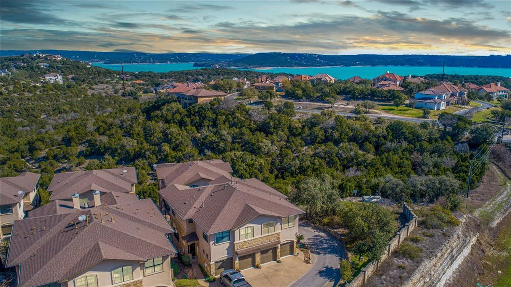 Lock & Leave End Unit with Views of Lake Travis & the Texas Hill Country. Minutes to Multiple Marinas and Boat Ramps on both Lake Austin & Lake Travis & Multiple Golf Courses. Ideally located between the Hill Country Galleria & Four Points - lots of nearby shopping & dining. Spacious rooms with lots of windows to take in the views of Hill Country and Lake Austin. Large balcony off both the family room and master bedroom. 14 Acre Community w/ Pool & Spa.  Currently Leased through April 2022 for $2,000 per month - perfect for investor or someone wanting to lock in 2021 prices to move in 2022.   Photos were taken in 2020 prior to current tenant moving in, decks are in the process of being replaced by the HOA and carpets were replaced 4/2021 and are not shown in these photos.