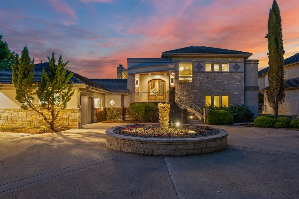 Masterful design & modern luxury are uniquely embodied in this gorgeous one-of-a-kind home in Lakeway. Stunning front entry doors and hardwood floors throughout most of the house. This house features the brilliance of Andersen Windows. Breathtaking Hill Country & lake views w/ a wine cellar, fire pit, outdoor fireplace, pool, & spa. A wall of windows and soaring ceilings allow tons of natural light to embellish this home. Fit for your resident chef; Kitchen includes SS appliances, sparkling granite, tile backsplash, 5-burner gas burner, kitchen island, breakfast bar, built-in double oven(s), microwave, and pantry. An abundance of cabinet and counter space makes this space a dream to cook in. The adjacent dining area makes this space ideal for entertaining. You have a dedicated bar area and wine cellar. Your master is spacious and serene. Your ensuite has a luxurious soaking tub, large walk-in shower, his and her vanity, tons of storage space, a water closet, and an expansive master closet. Feel like you're stepping into a spa every time you walk into this exquisite space. Owner's suite + stunning en suite, complete with flex room, walk-in shower/jacuzzi tub. Off your en suite retreat to your relaxing sitting room to recharge and relax. You'll find subtle details in this spectacular house. You have a dedicated office with built-in cabinets & shelves. Media room with built-in storage and cabinets. Mudroom & laundry room. Resort-style living in a private oasis backyard w/ multiple outdoor areas. Allow yourself the luxury of nestling into one of your many outside areas for a morning cup of coffee or entertain in style under your cover patio by the pool and spa. Venture down towards the fire pit or take a bridge and trail to the day dock head and the lake. Feel like you're living in a resort every time you come home.